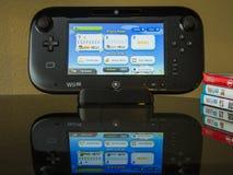 Almofada do jogo de Nintendo Wii U no suporte Imagem de Stock