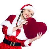 Almohadilla del corazón de la Navidad de Papá Noel de la mujer Imágenes de archivo libres de regalías