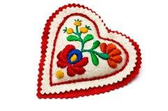 Almohadilla en forma de corazón de la aguja Fotos de archivo libres de regalías