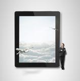 Almohadilla táctil con el aeroplano imágenes de archivo libres de regalías