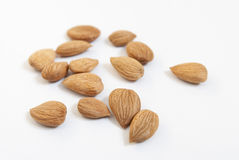 Almond. Nuts on the white background Stock Images