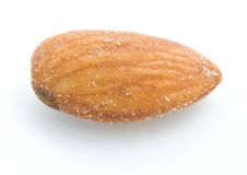 Almond. A macro shot of a brown almond over a white background Royalty Free Stock Image