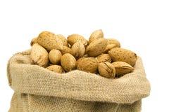 Almond. S in burlap sack craft Royalty Free Stock Photo