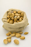 Almond. S in burlap sack craft Royalty Free Stock Photography