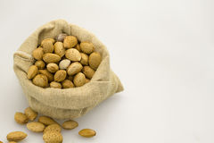 Almond. S in burlap sack craft Stock Photography