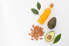 Almond and avocado oil in bottle. Skin care and hair loss ingred. Ients Stock Photo