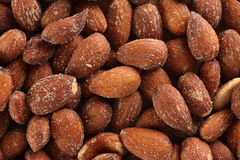 Almond background. Almond nut, closeup texture, salted and tasty, good for heart Stock Photos