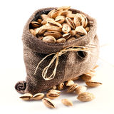 Almond in the bag. nuts on white. Background Royalty Free Stock Images