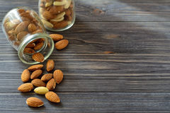 Almond  in the bank on a dark wooden background Stock Photo