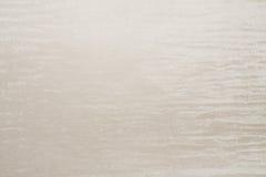 Artificial fabric texture almond beige color Stock Photos