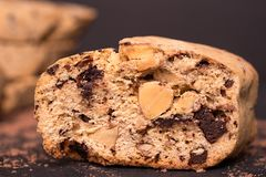 Almond biscotti biscuits. Food background. Chocolate almond biscotti, cantucсini. Slice of chocolate biscotti on a black background, detail, macro, close-up stock photo