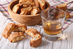 Almond biscotti biscuits and sweet wine in a glass. Horizontal. Italian almond biscotti biscuits and sweet wine in a glass on the table. Horizontal royalty free stock photography