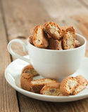 Almond biscotti. In white cup stock images