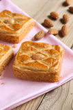 Almond biscuits on pink tablecloth Royalty Free Stock Photos
