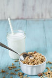 Almond Breakfast Cereal Granola With Glass of Milk And Spoon Royalty Free Stock Photos