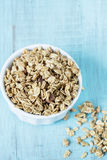 Almond Breakfast Cereal Granola In White Bowl. Almond breakfast granola in white bowl on blue background royalty free stock photography