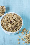 Almond Breakfast Cereal Granola In White Bowl With Spoon Stock Image