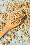 Almond Breakfast Cereal Granola On Wood Spoon From Above. Almond breakfast granola spilling around wooden spoon close up royalty free stock photography