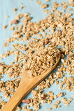 Almond Breakfast Cereal Granola On Wood Spoon. Almond breakfast granola spilling around wooden spoon royalty free stock photos