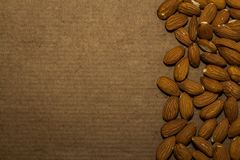 Almond on a brown backgroundnn. Almonds on a brown background with the edges of the image stock photos