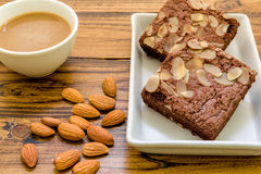 Almond Brownie for Coffee Background / Almond Brownie for Coffee / Chocolate Almond Brownie for Coffee Background Royalty Free Stock Photo