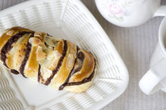 Almond buns on white plate Royalty Free Stock Photo