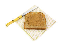 Almond butter wheat toast with knife Stock Images