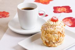 Almond cake. Decorated almond cake with cherry and coffee Royalty Free Stock Photography