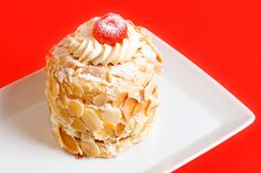 Almond cake. Decorated almond cake on red Royalty Free Stock Photo