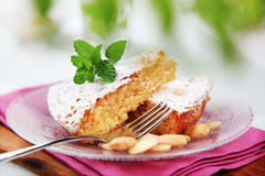 Almond cake. Slices of almond cake sprinkled with powdered sugar Royalty Free Stock Image