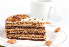 Almond cake. And with a coffee mug  on a table Stock Photography