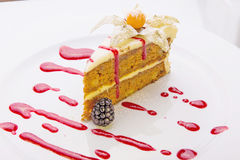 Almond cake. (air meringue with a delicate cream and almonds under vanilla sauce Royalty Free Stock Photos