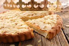 Almond cake. And crown on wood Stock Images