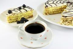 Almond cake and coffee Stock Photos
