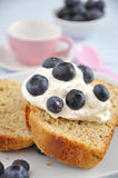 Almond Cake with cream and blueberries Royalty Free Stock Images