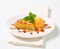 Almond cake with ice cream and caramel sauce Stock Photo