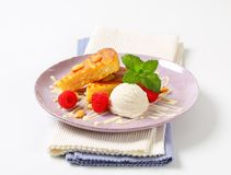 Almond cake with ice cream and raspberries Stock Photos