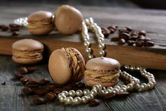 Almond cakes, coffee beans and pearl. Stock Images