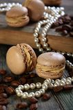 Homemade macaroons and coffee beans. Royalty Free Stock Photo