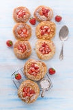 Almond cakes with vanilla and strawberries Stock Photo