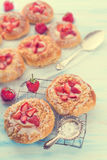 Almond cakes with vanilla and strawberries Stock Image