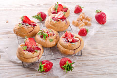 Almond cakes with vanilla and strawberries Royalty Free Stock Image