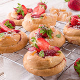 Almond cakes with vanilla and strawberries Stock Photos