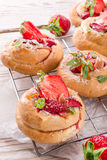 Almond cakes with vanilla and strawberries Royalty Free Stock Photo