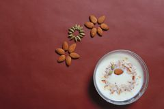 Almond And Cardamom design with sweet dish in bowl stock images