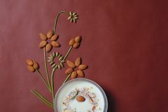 Almond And Cardamom design with sweet dish in bowl royalty free stock photo