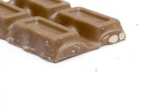 Almond Chocolate Bar Section. A broken milk chocolate bar with almonds stock photo