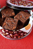 Almond and chocolate chip brownies in a tin box Royalty Free Stock Photo