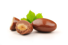 Almond chocolate dragees with clipping path. Almonds, sugared almonds, chocolate-coated outside, and leaves a white background image is also available Stock Images