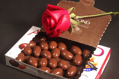Almond chocolates and rose. Some almond chocolates in box and rose Royalty Free Stock Image